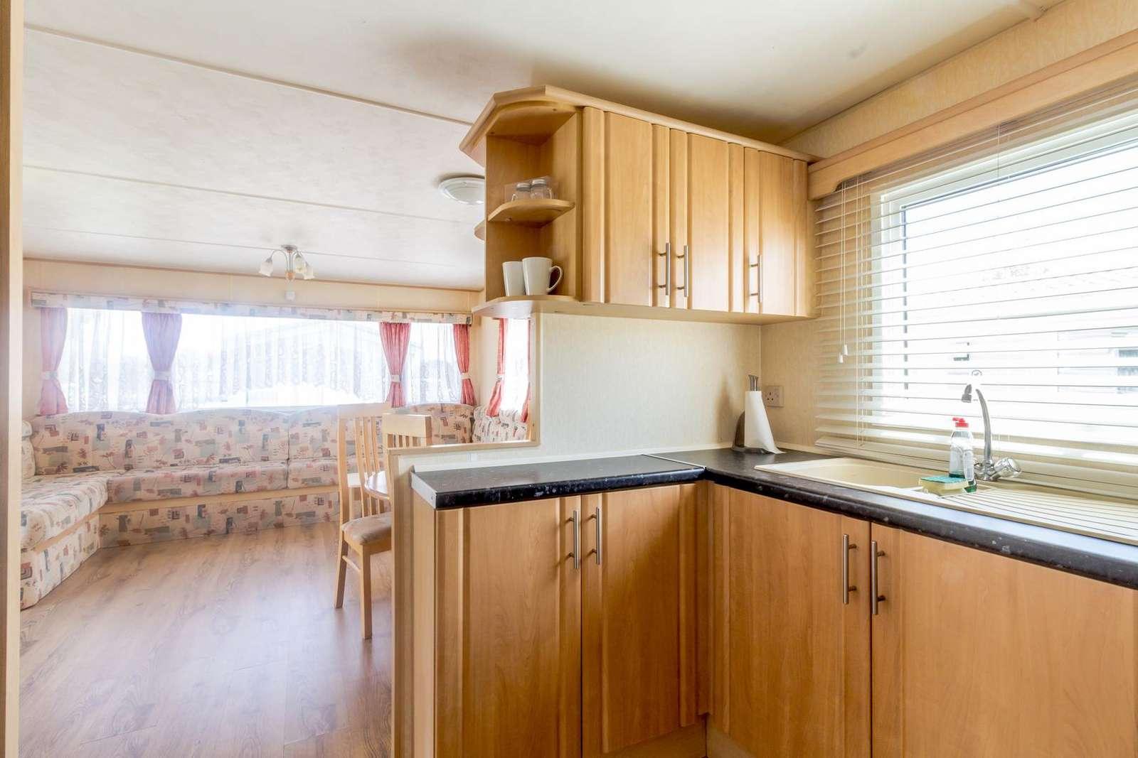 Modern kitchen leading to spacious lounge