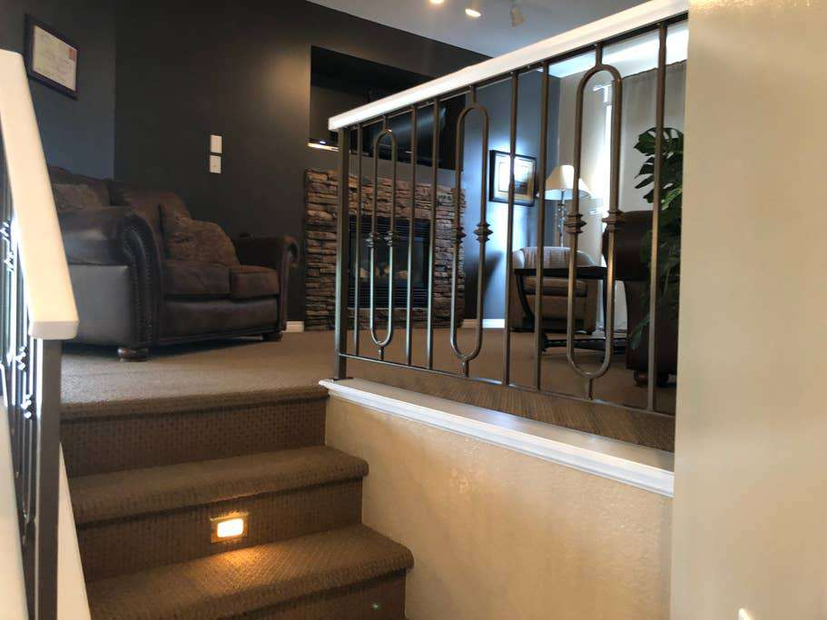 Upper level condo stairs to living room