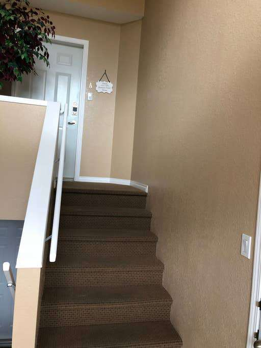 After entering front door, up the stairs to upper-level condo or downstairs to lower level condo. Each entrance has its own lock for privacy if wanted.