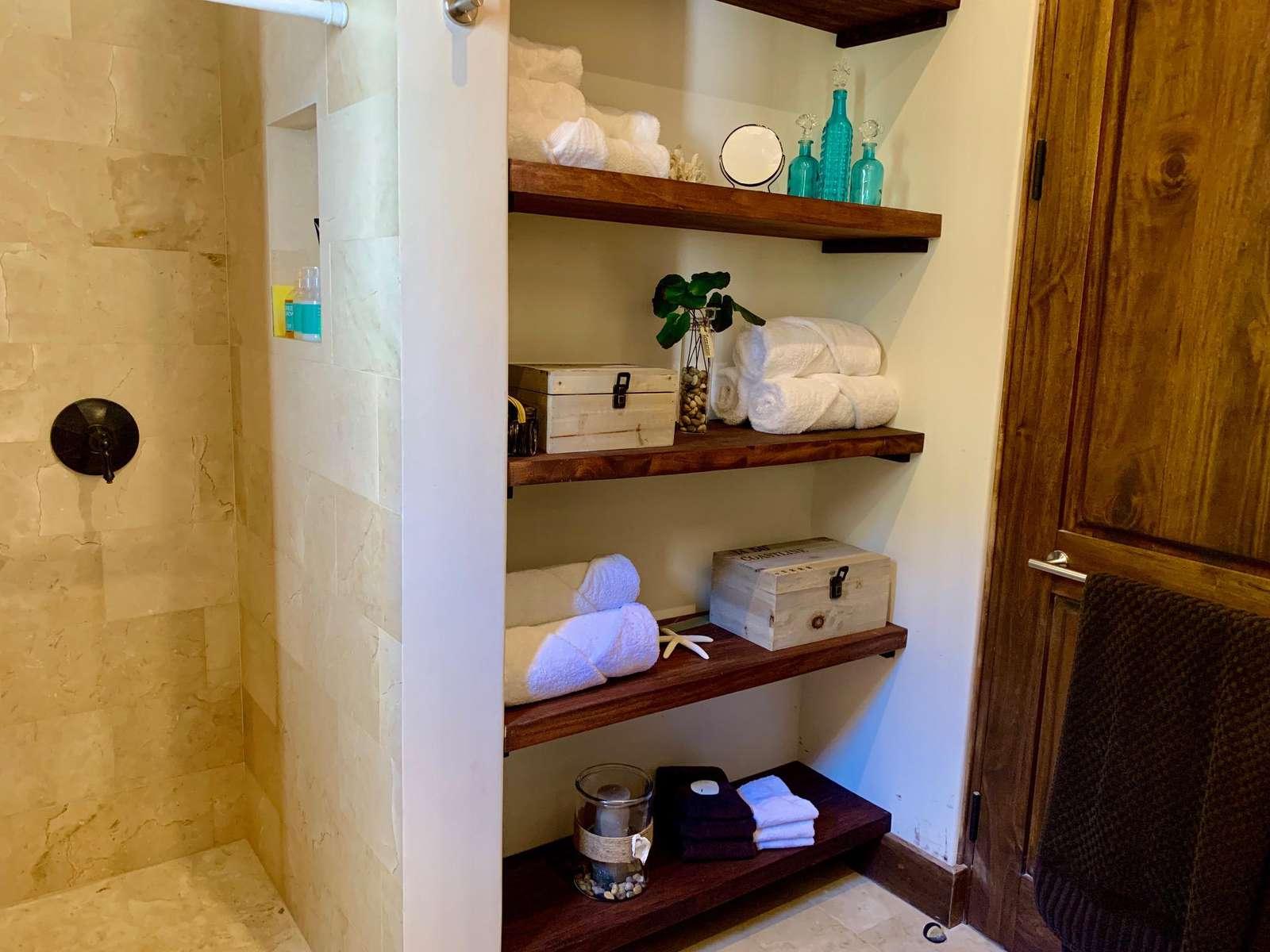 Walk in shower, storage area