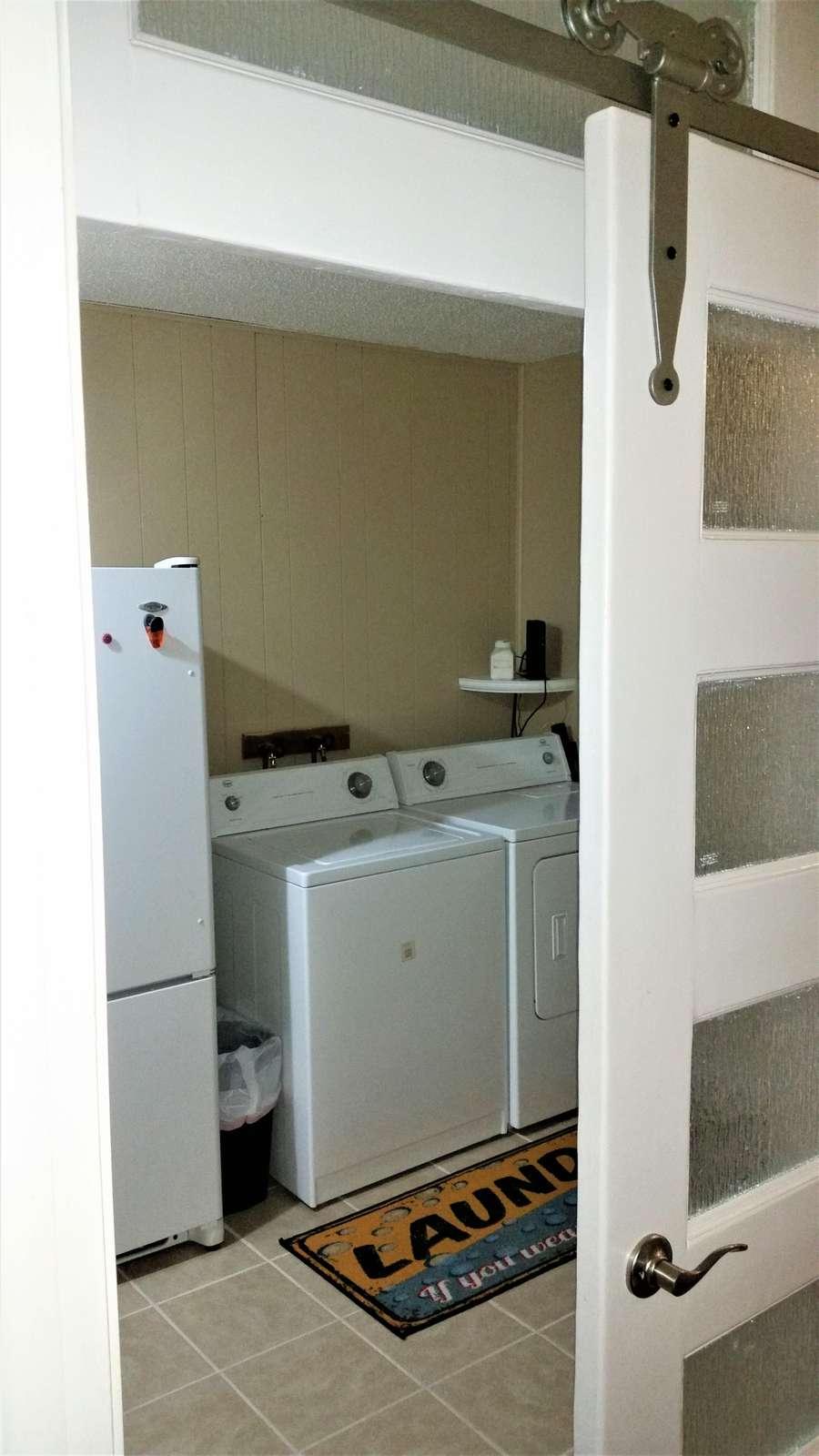 Laundry room with extra refrigerator