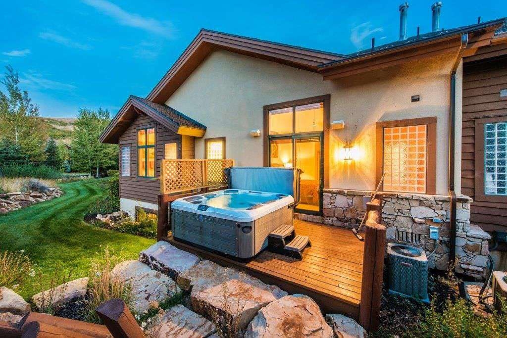 Open Space in backyard and giant hot tub