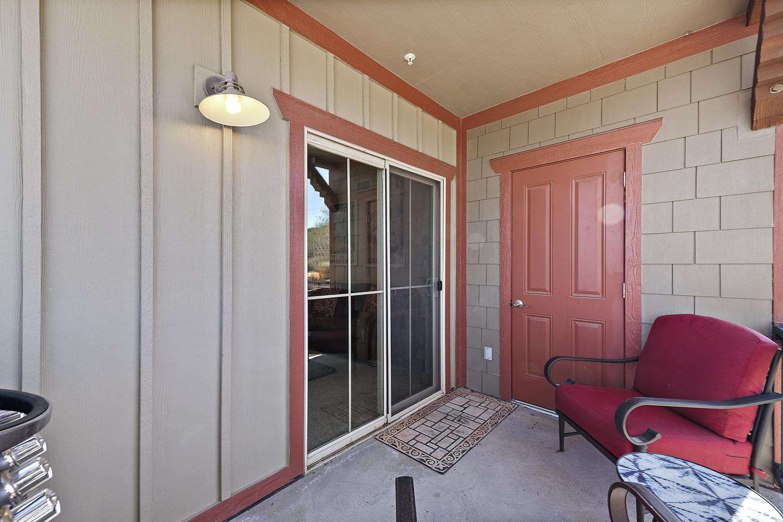 Balcony with sliding door entrance to living room