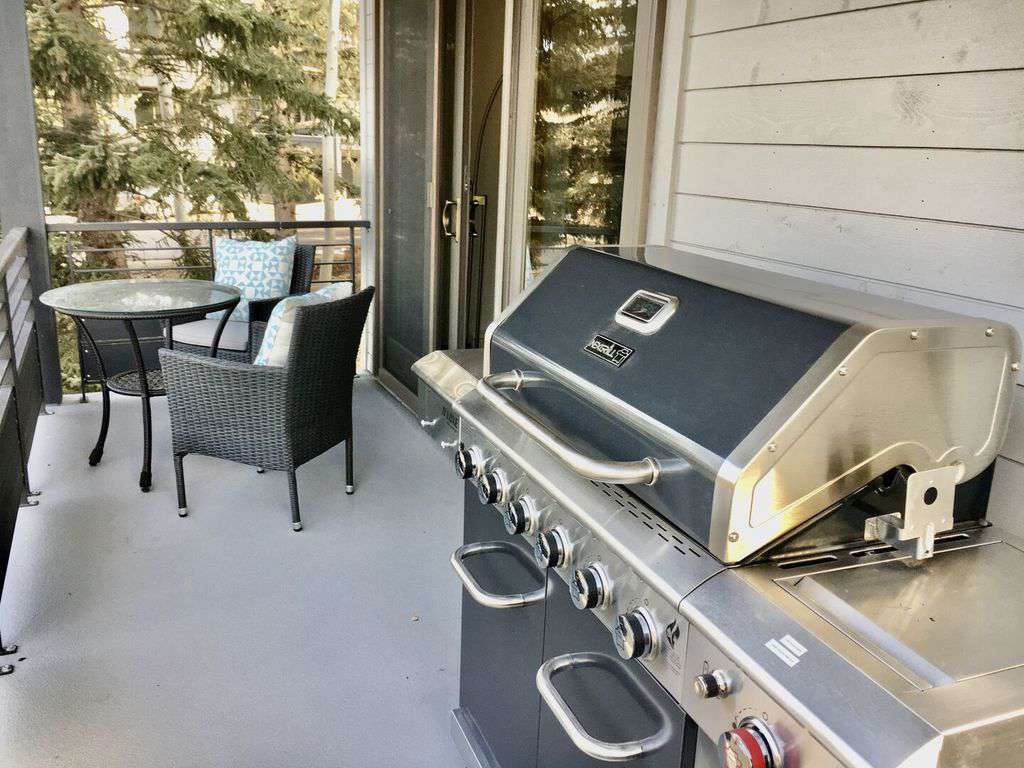 Barbecue grill on main level deck