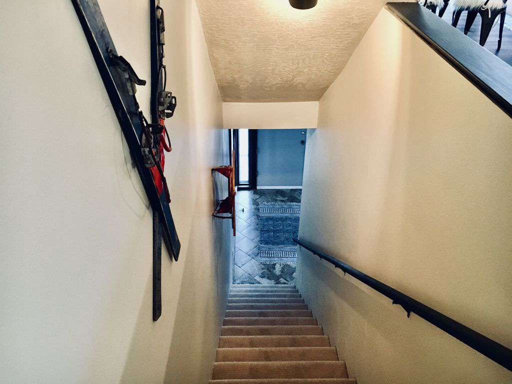 Stairway leads from the entry area to the lower level bunk and game rooms