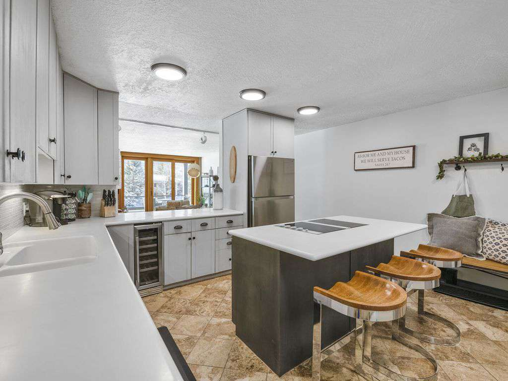Kitchen opens to living area
