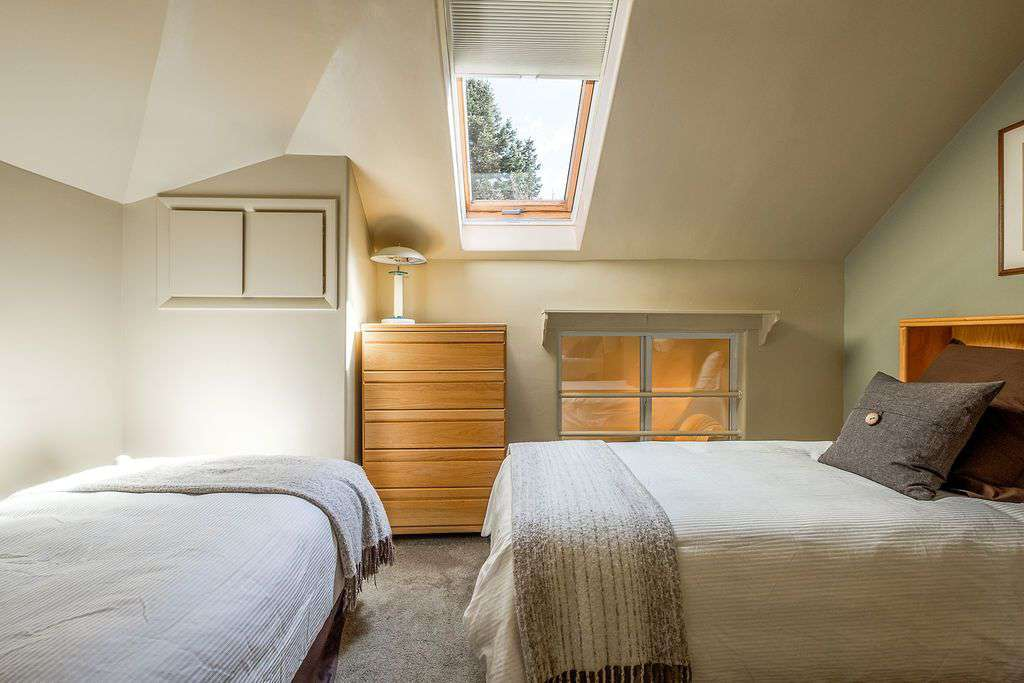 Fourth floor bedroom with skylight window