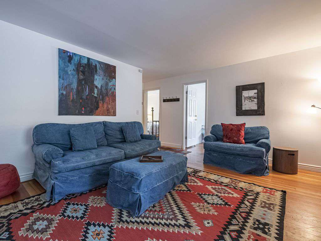 Living room with sofa bed and hardwood floors