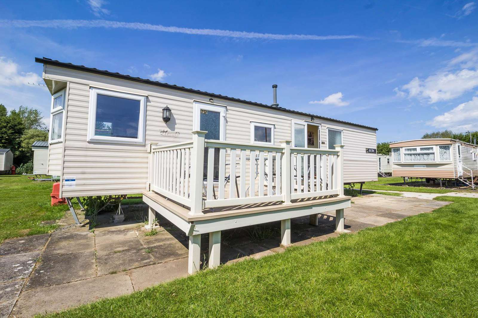 33068F – Firs area, 3 bed, 8 berth caravan near to amenities with decking. Ruby rated. - property