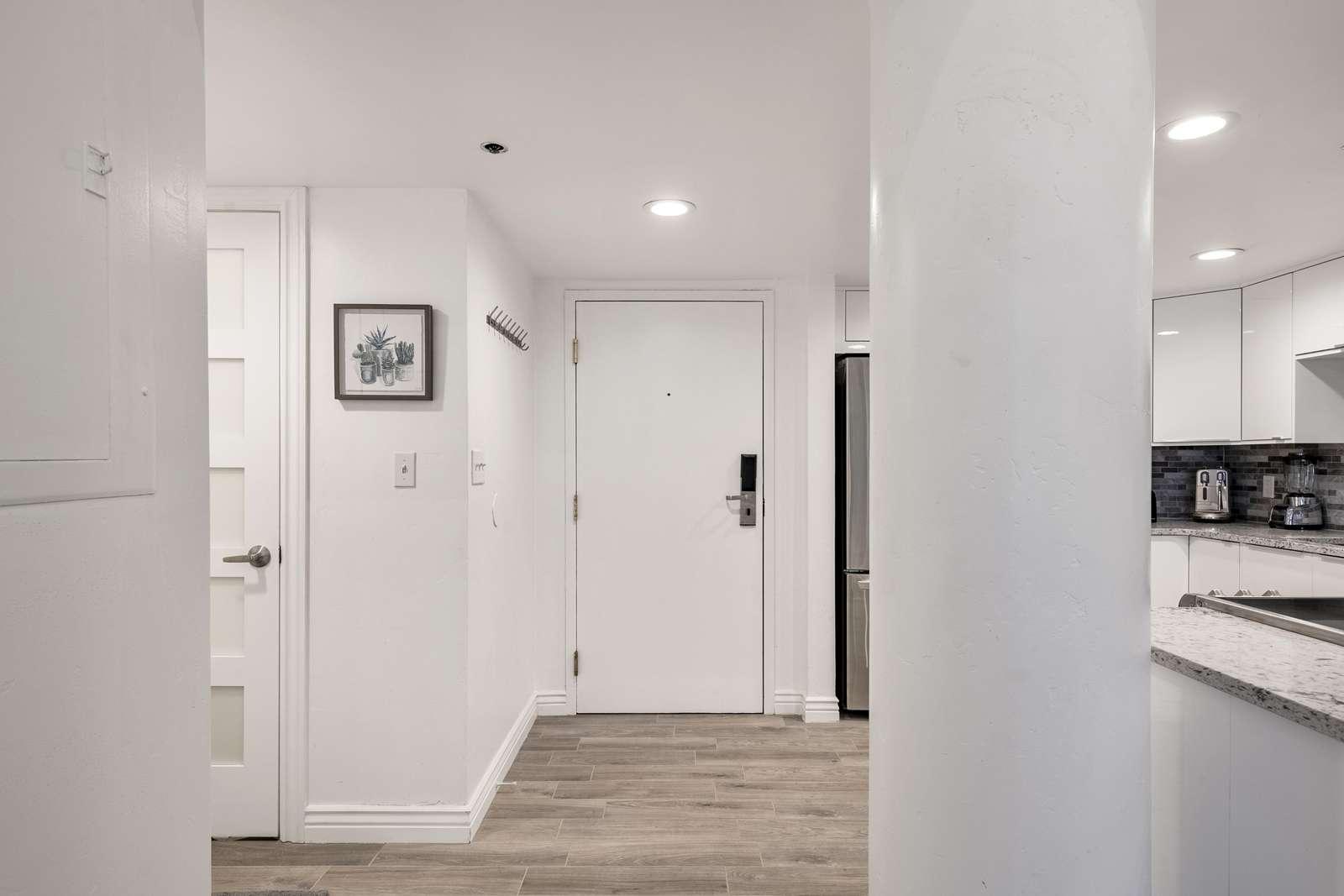 Entry door, and bathroom door on left