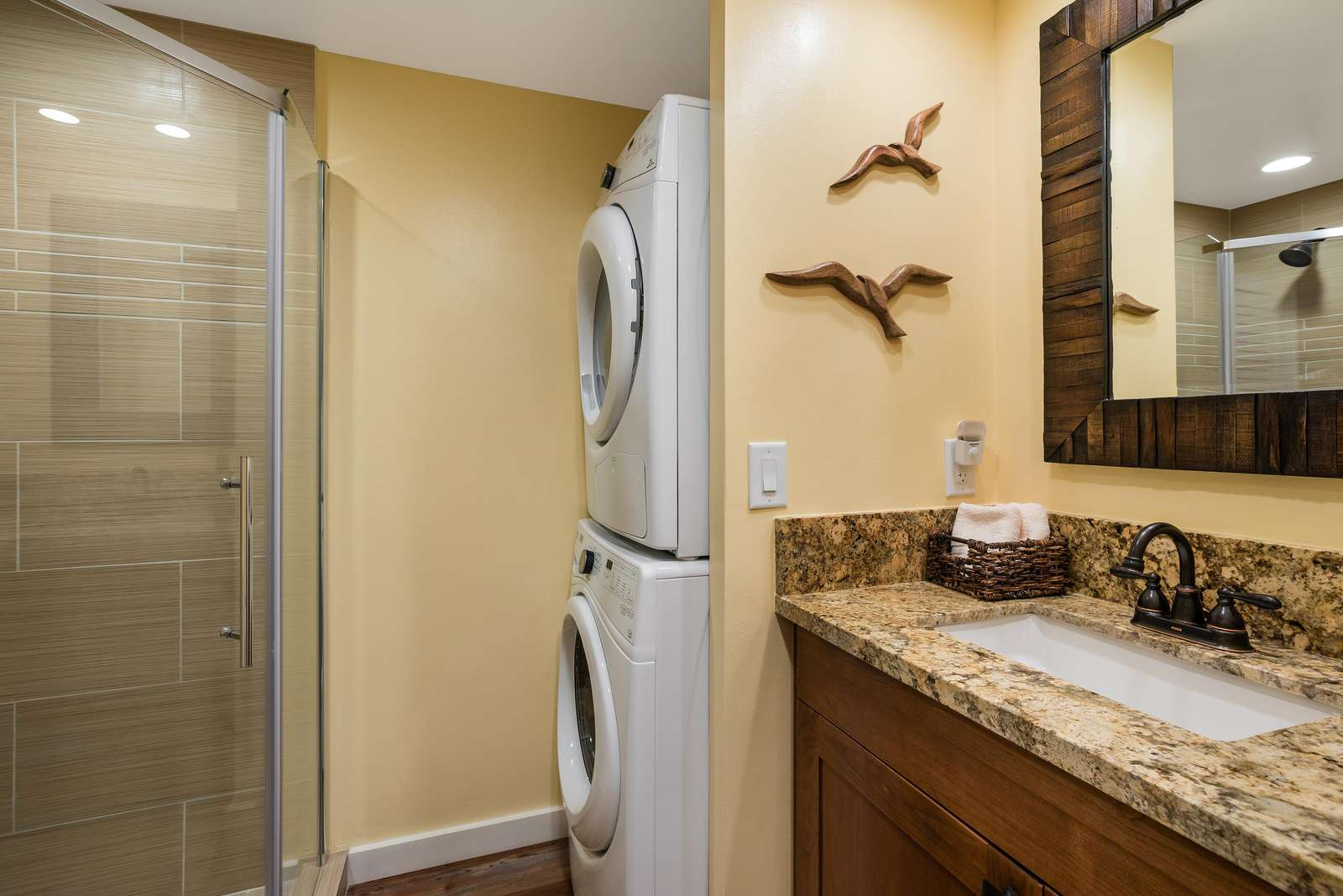 Guest bath with shower and full size washer/dryer.