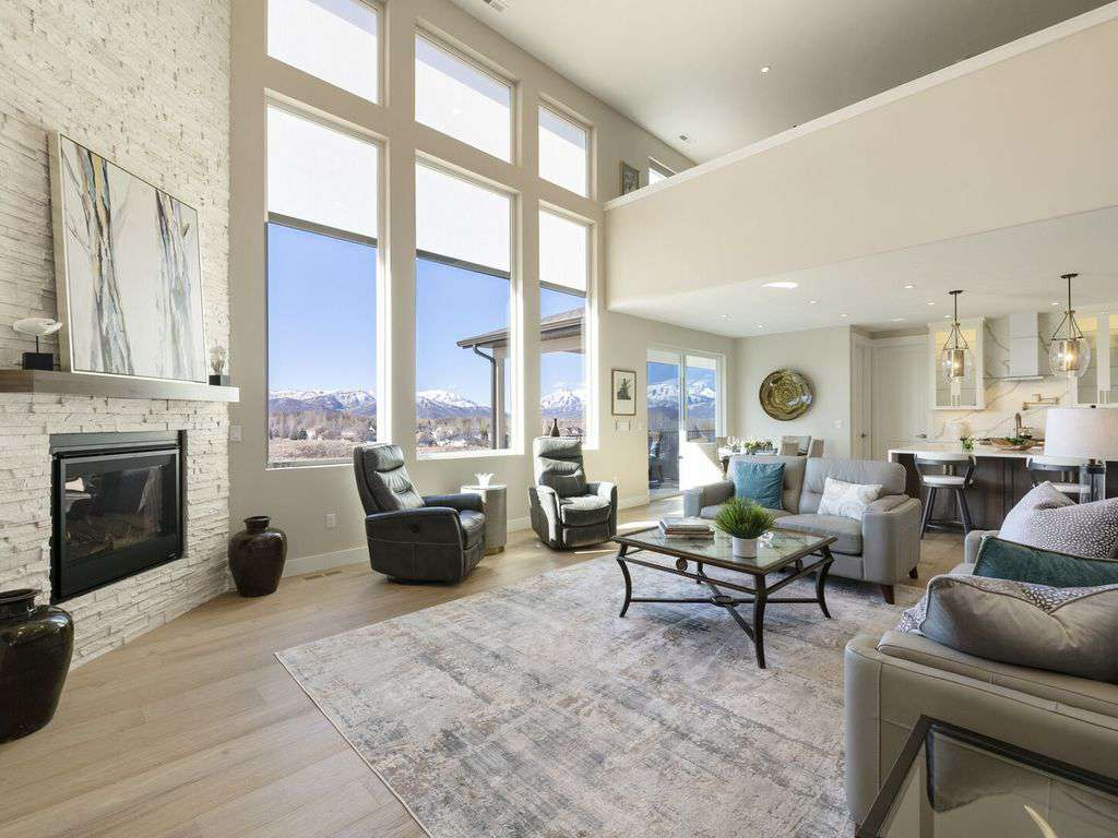 Vaulted living area with mountain views