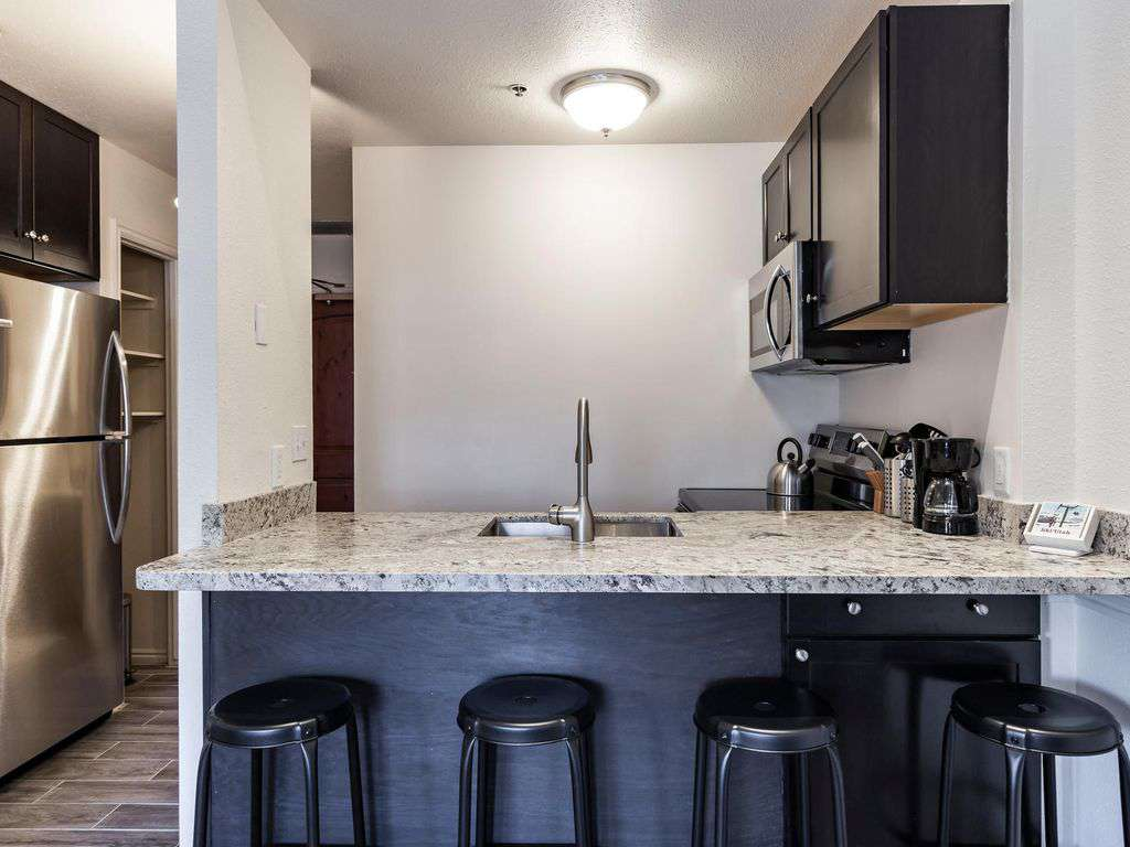 Marble countertop and full size frig