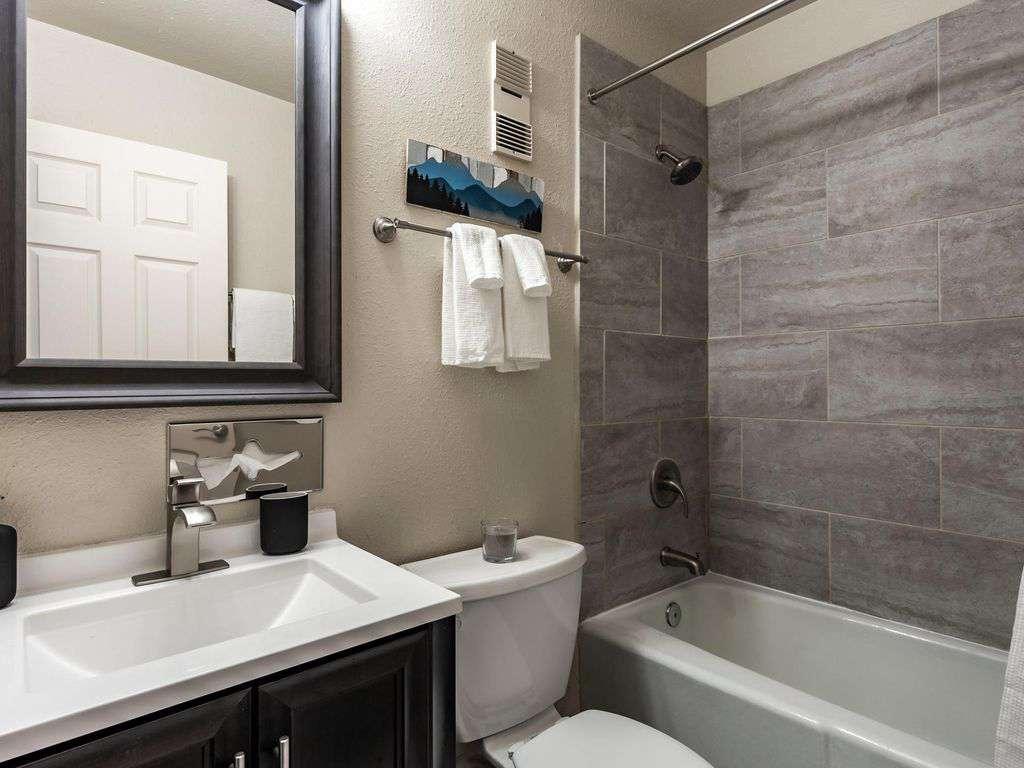 Shared bathroom next to kitchen