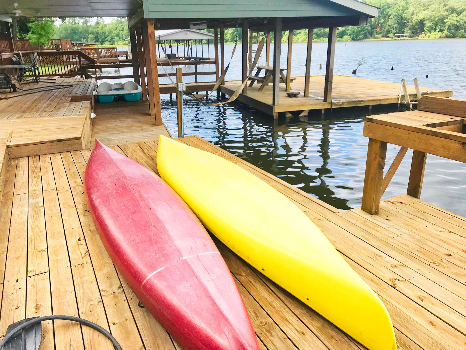 The dock and the two kayaks that come with the site. There are times a dock at another home might be used, they are all very nice and can be seen in our house listings.