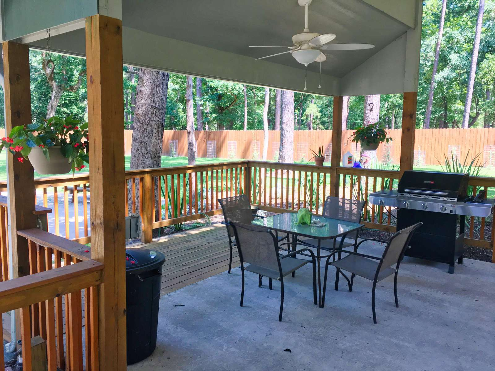 The seating area with fan and deck rail lighting