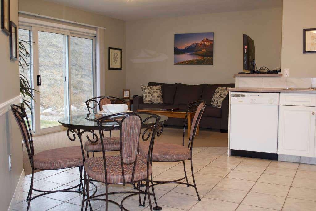 Dining, kitchen, living room and door to patio as seen from bedroom doors.