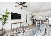 Living area, futon sofa, Smart TV thumb