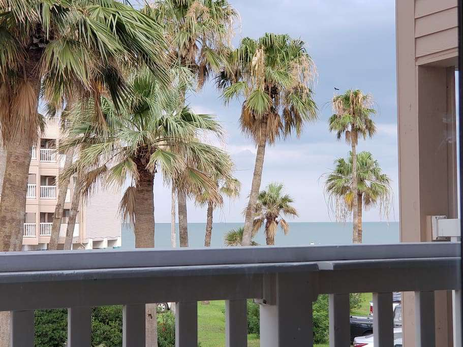 Directly over the pool out the front door, and a tropical view of the beach and water from the balcony!   Good location!