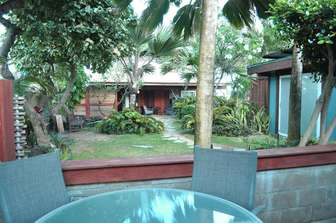 PAPAYA Patio with garden views and path to ocean. thumb
