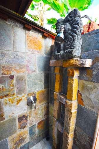 View of shower in outdoor bathroom of TIki Moon Villas thumb