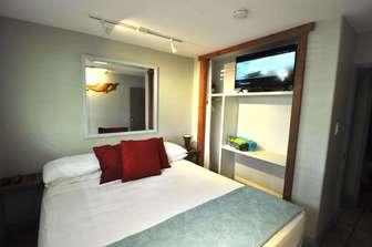 PAPAYA bedroom #1 king bed. thumb