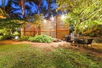 Garden area near ocean at Tiki Moon Villas thumb