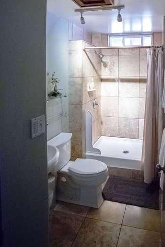 PAPAYA Bathroom with walk in shower. thumb