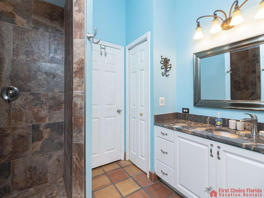 Coastal Hideaway Guest Bathroom with Shower and Vanity