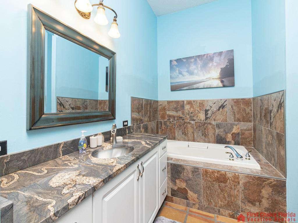 Coastal Hideaway Guest Bathroom with Tub