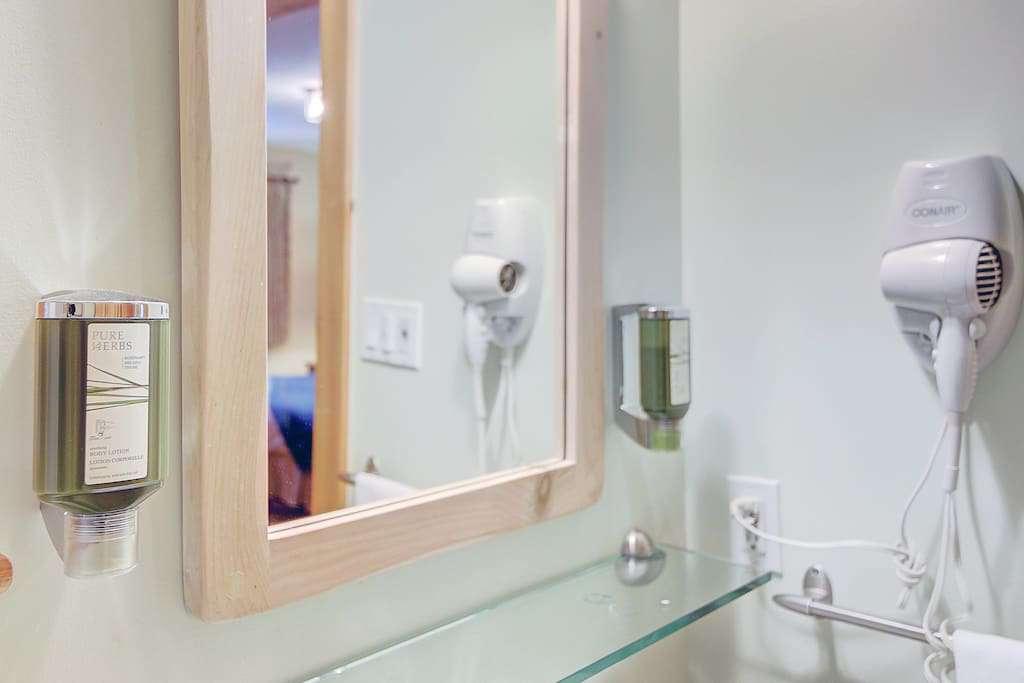 Washroom with showel gel,shampoo and hair dryer