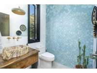 Guest 1/2 bathroom, teak countertops, petrified wood sink thumb
