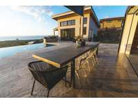 View of detached apartment and outdoor dining area thumb