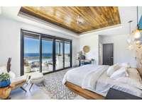 Master bedroom, king bed, ocean views, private bathroom thumb