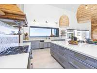 Gourmet kitchen, fully stocked, wood cabinetry, quartz countertops, stainless steel appliances thumb