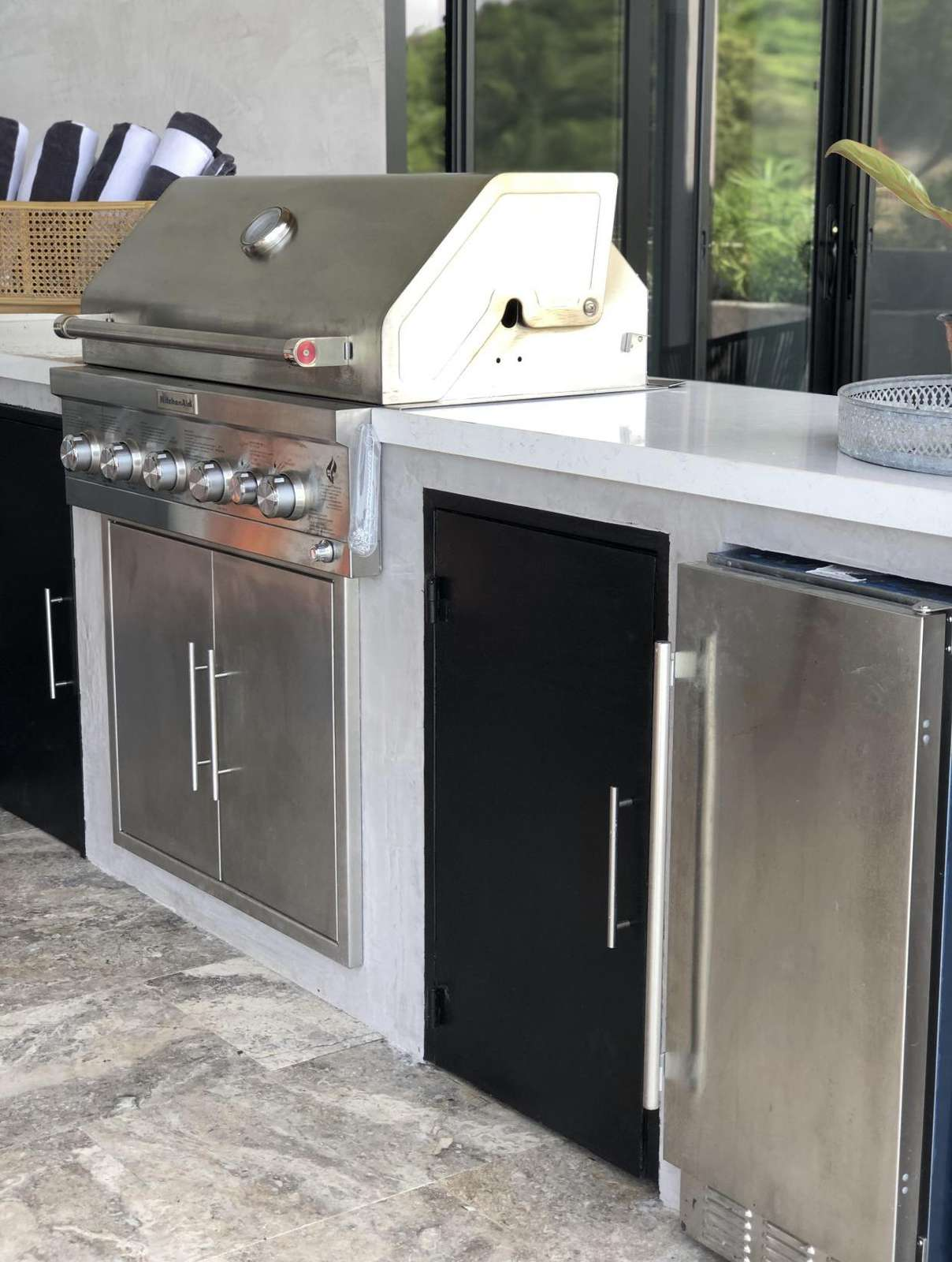 Outdoor kitchen area, BBQ gas grill, icemaker, refrigerator