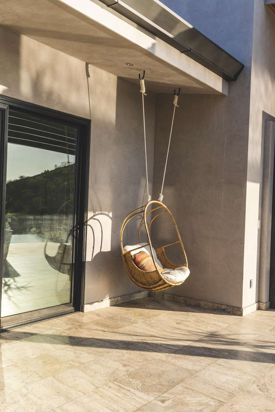 Chair hammock on the covered terrace area