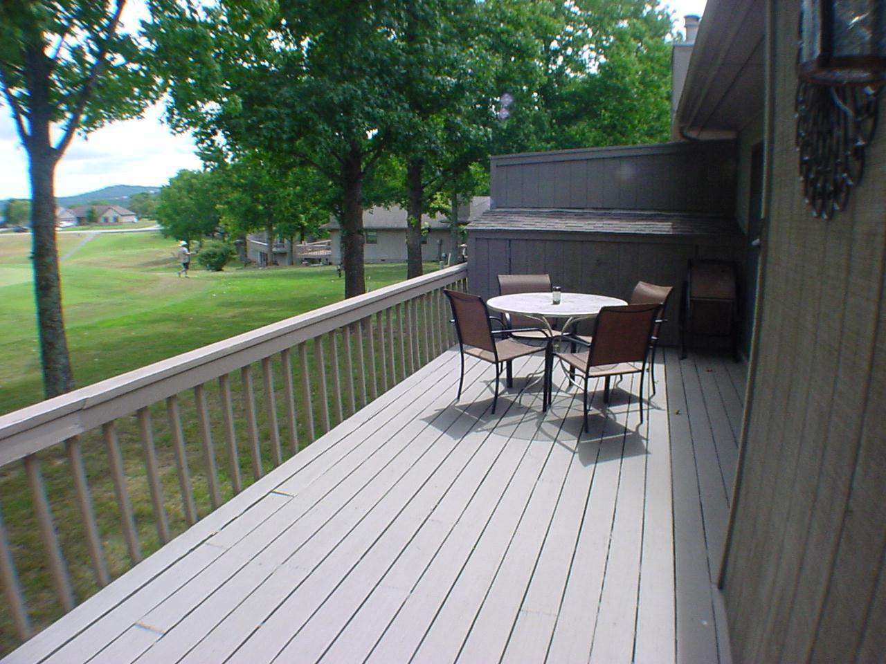 Large deck with a golf course view