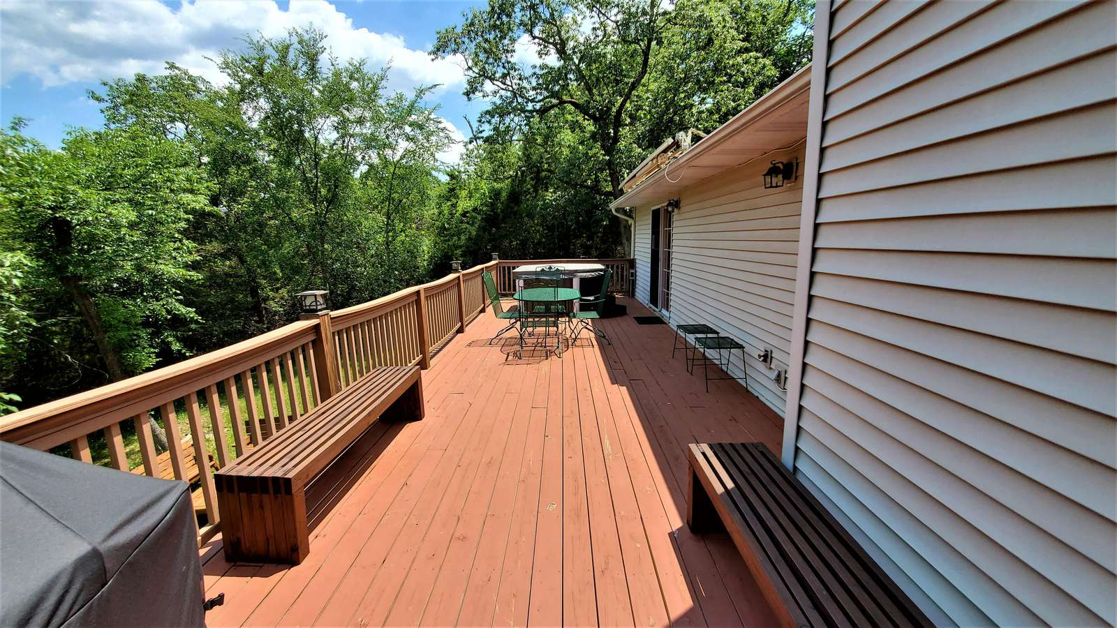 Large deck with hot tub and roll out awning