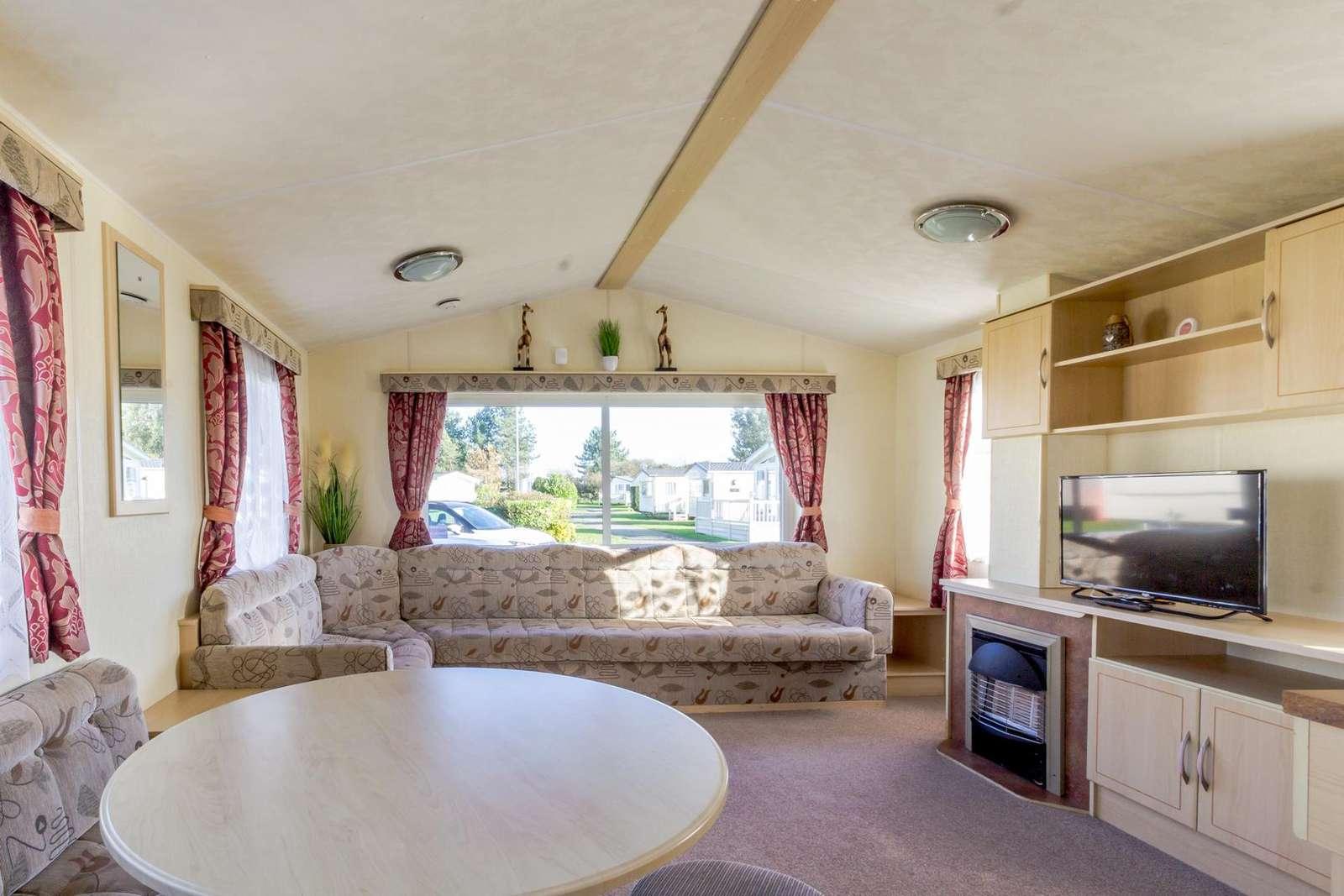 10030B – Bure Village area. 3 bed, 8 berth caravan. Emerald rated. - property