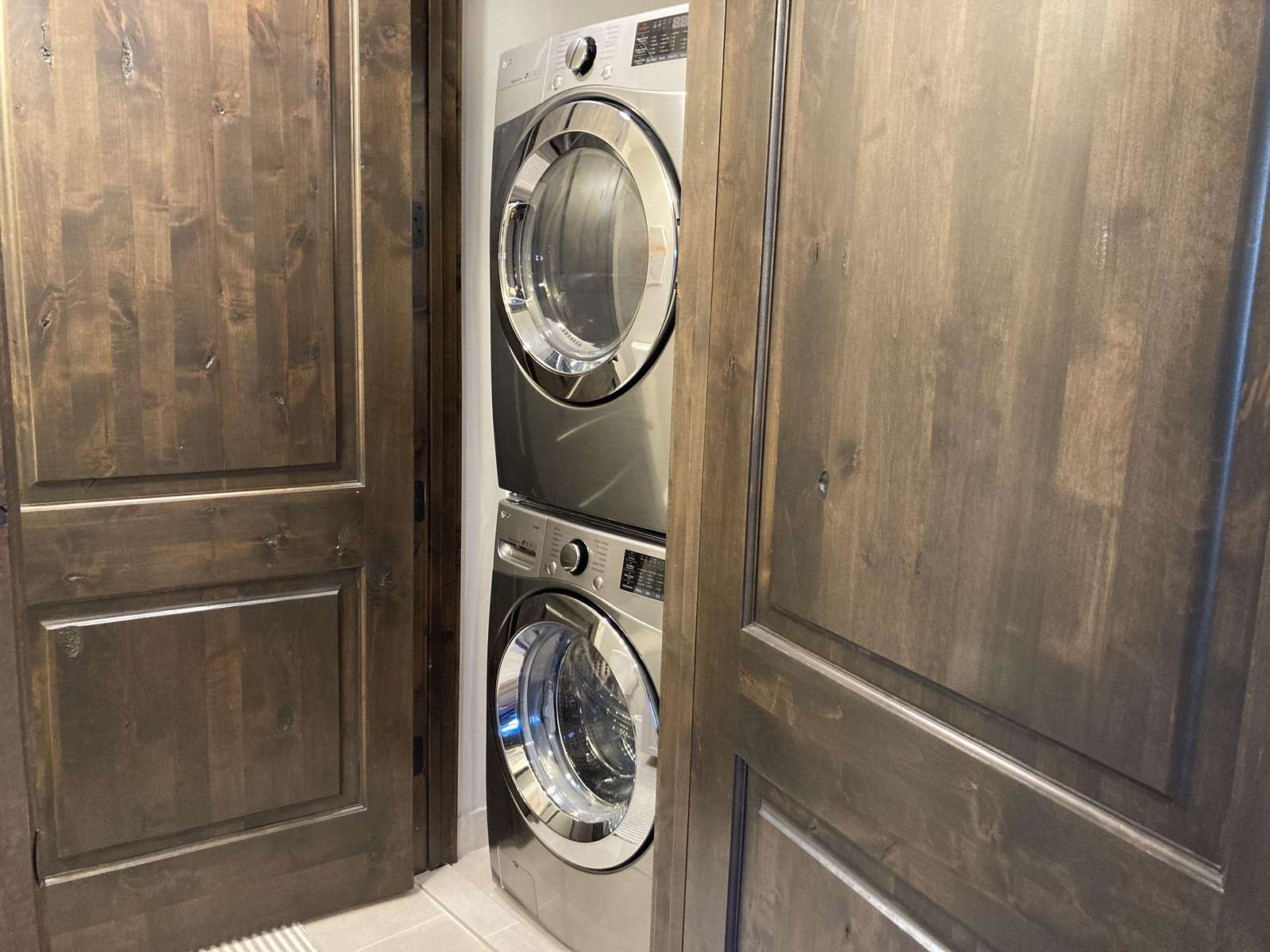 Washer and dryer in the half bathroom next to kitchen