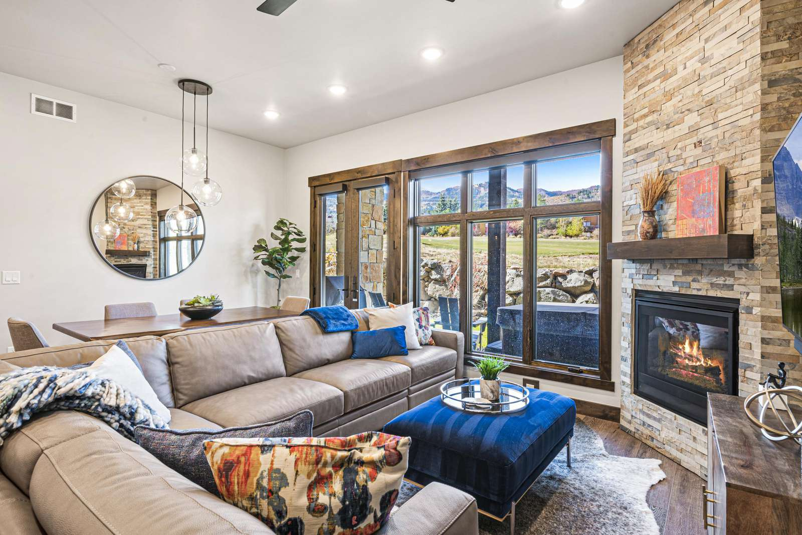 Relax in a spacious living and dining area and view the ski slopes