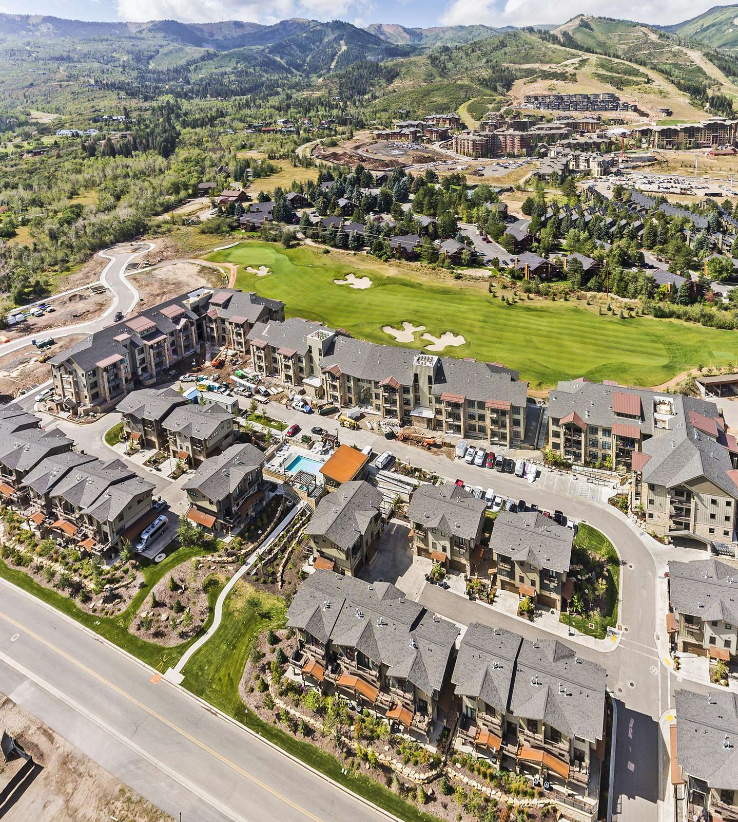 Aerial view of the condo development, golf course, and ski resort