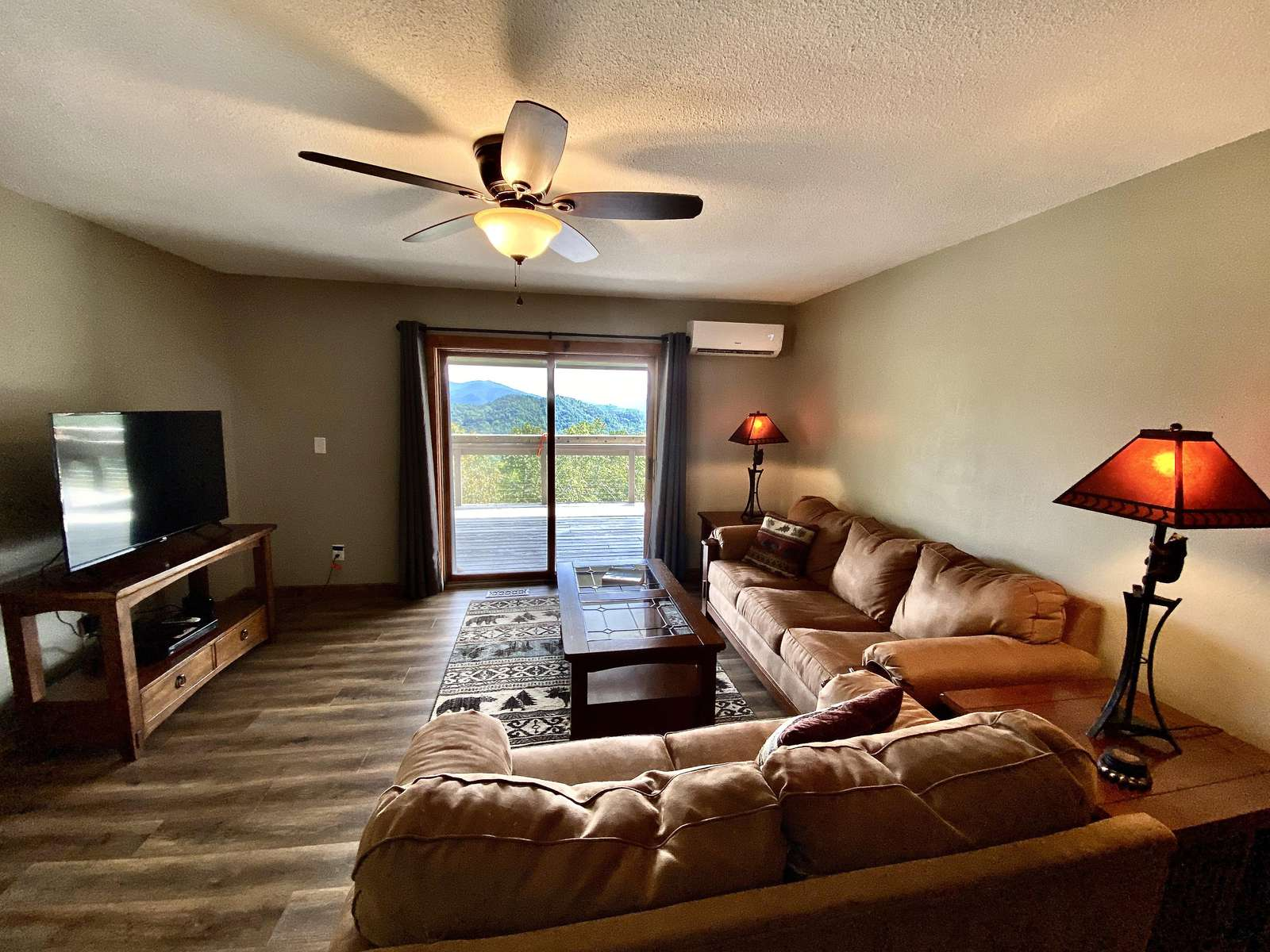 Just steps from the Queen Bedroom is a Spacious Lounge with Satellite TV