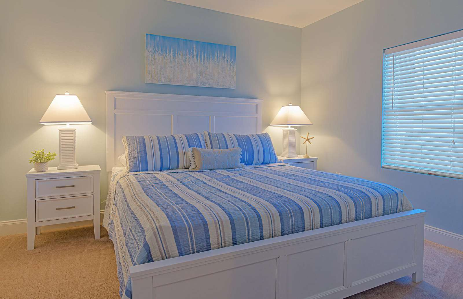 The guest bedroom features a comfy king bed and more!