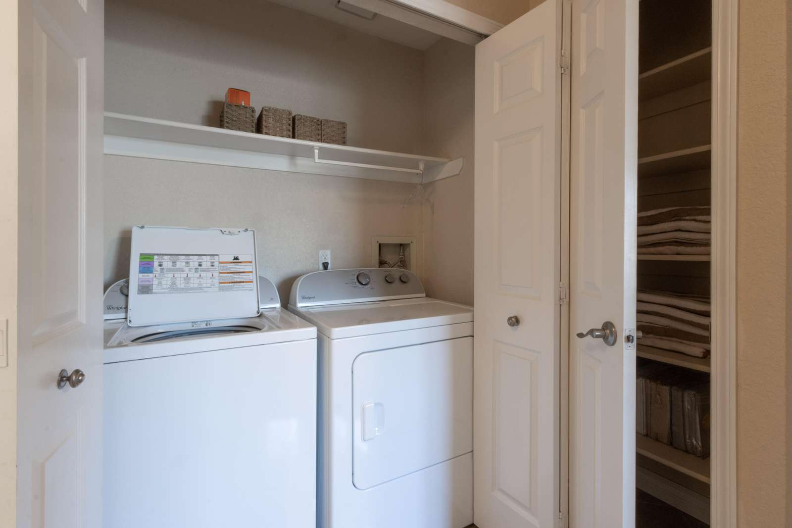 laundry closet with folded doors