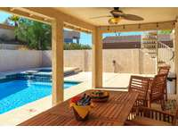 Back patio with pool and spa thumb