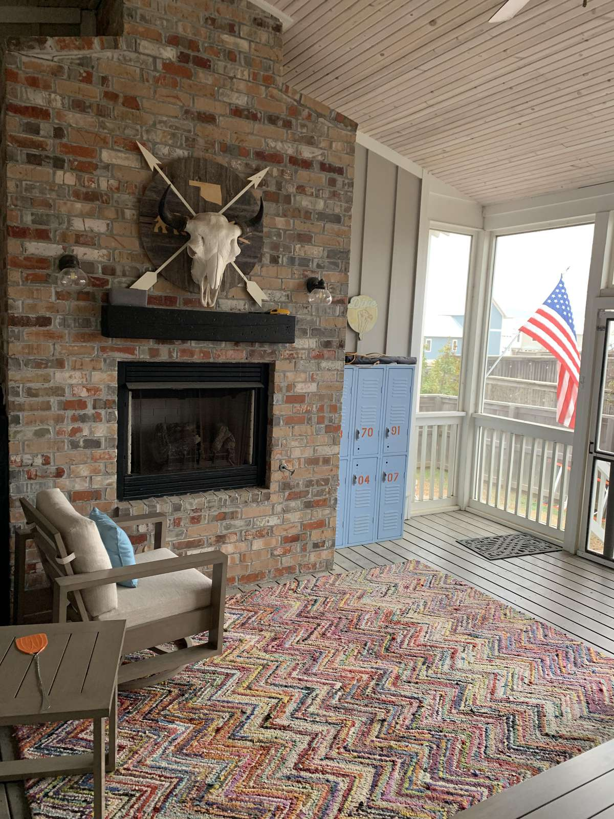 Screened In porch with fireplace - perfect place for enjoying the evening