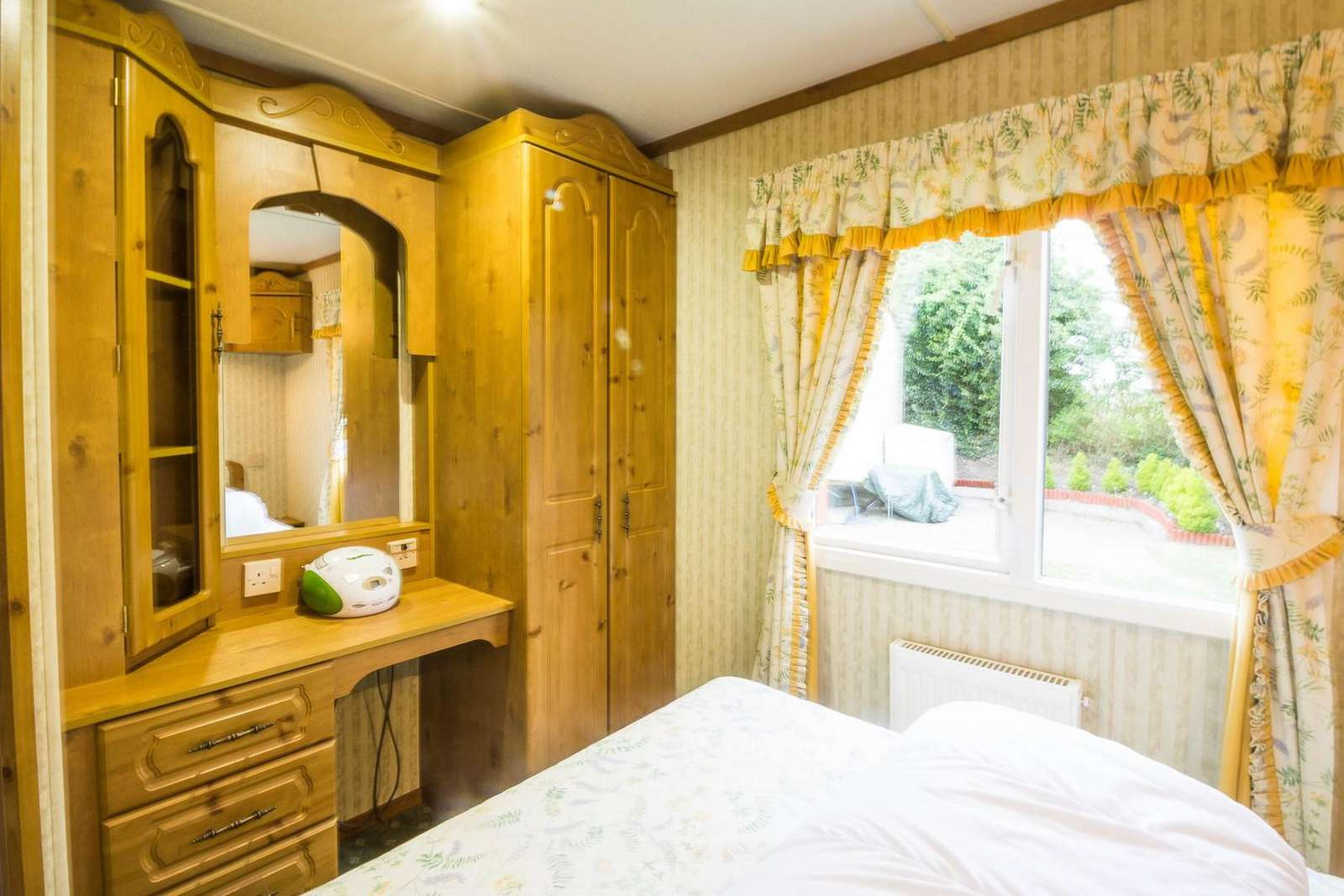 Great dressing table and wardrobe space in this caravan for hire.