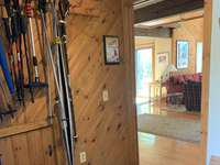 Entry mudroom with benches, coat hooks, ski racks thumb